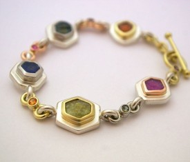 Linked multi-colored Montana sapphire bracelet featuring rough and faceted Montana sapphires in palladium, 18k Italian yellow gold, 14k rose gold and sterling silver