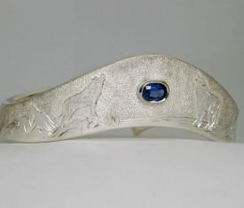 Custom hand engraved sterling silver Wolf Bracelet