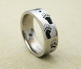 Narrow grizzly bear track ring with blackened tracks in 14k white gold.