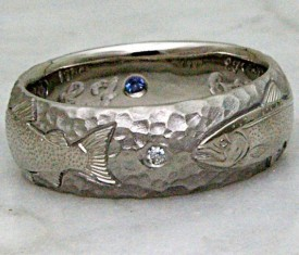Custom hand engraved salmon ring with diamond and Montana yogo sapphire accents.