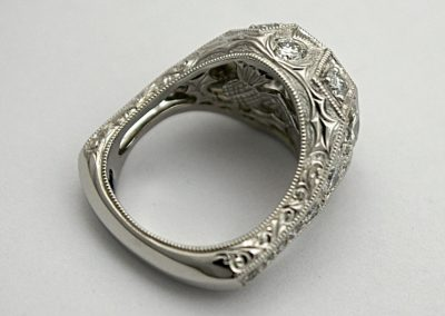 The decorative sides of the diamond ring.