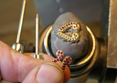 The rubies are tiny. Setting happens with a microscope.