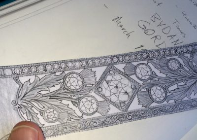 Artwork to be scribed and pierced in Platinum.
