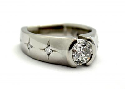 7ct diamond engagement ring with star set accent diamonds, palladium