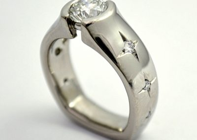 .7ct diamond engagement ring with star set accent diamonds, palladium