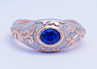 Old world Viking style, engagement ring,  .60ct Montana Sapphire, hand engraved rose gold overlay, palladium