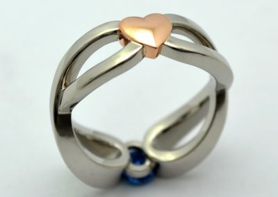 .60ct oval Yogo sapphire engagement ring, eternity symbols and heart, palladium and rose gold